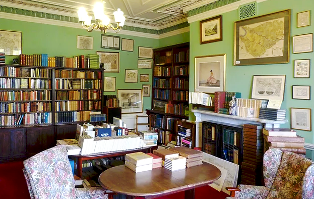 The Antiquarian Room of Bookends Carlisle, complete with maps and chairs
