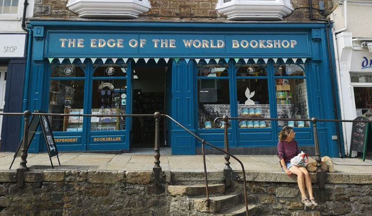 The blue shopfront of The Edge of the World Bookshop on the Land's End Round walking holiday