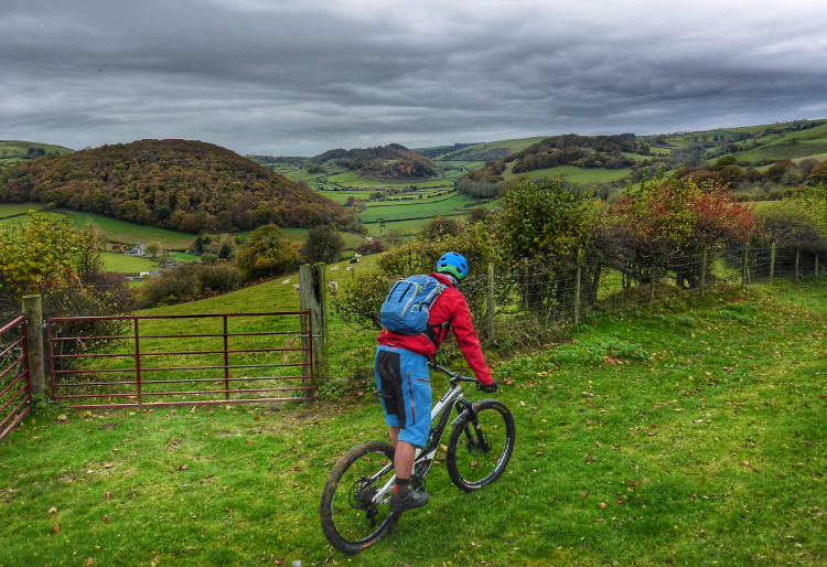 Riding to a countryside gate on the Trans Cambrian Way