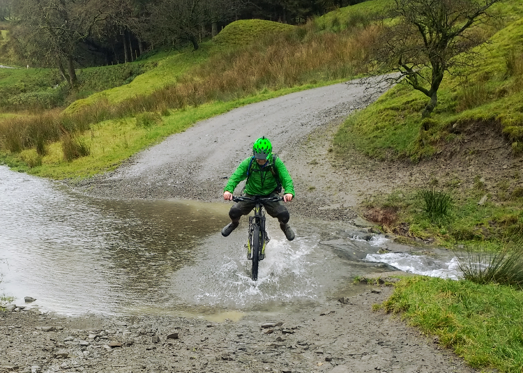 Splashing through a puddle across the bridleway