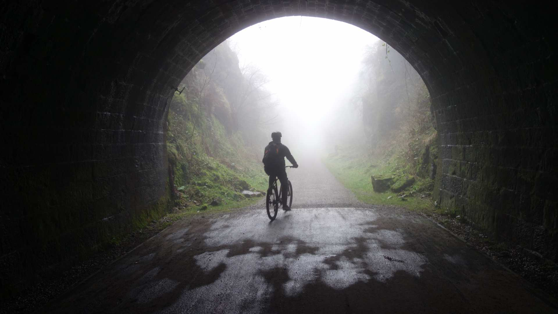 Cycling through Chee Tor Tunnel in the White Peak